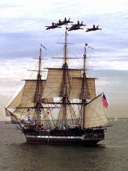 The Blue Angels fly in formation over the U.S.S. Constitution