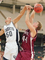 Central Catholic's Eric Washington, left, blocks the