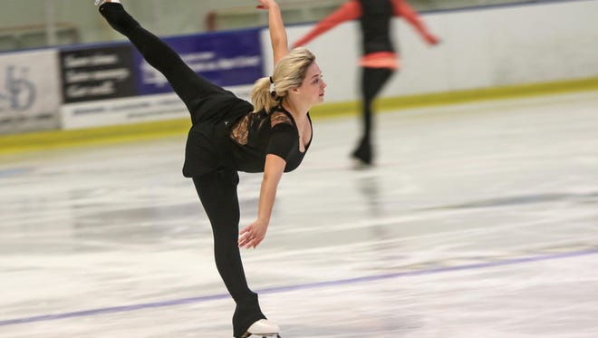 Emily Boas, 21, of Perryville, Md., glides across the ice during practice for the National Solo Dance Final, running Thursday through Sunday, at the University of Delaware in Newark.