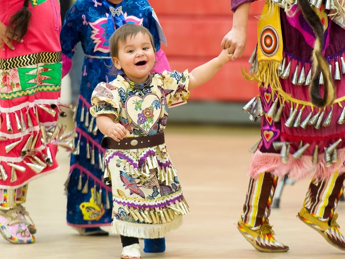 Gracie Leslie, 18 months, laughs while dancing with