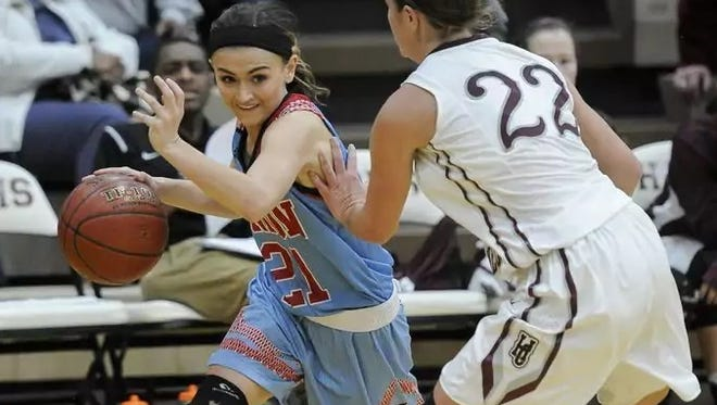 Union County's Tori French drives past Henderson County's Mary-Kate Daniel during the game.