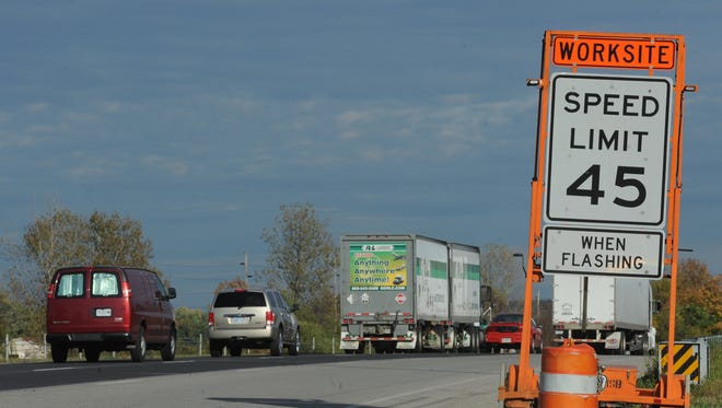 Signs warn of construction on Interstate 70 in Wayne County.