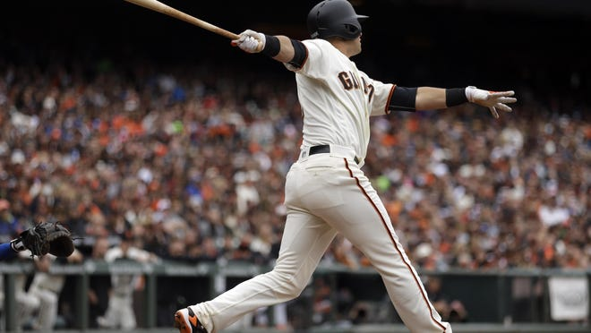 San Francisco Giants' Joe Panik swings for a two-run double in the sixth inning of Sunday's game against the Dodgers.