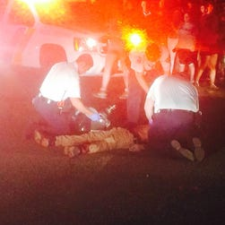 Authorities attend to people following a shooting Aug. 3, 2015, in Holmdel, N.J.