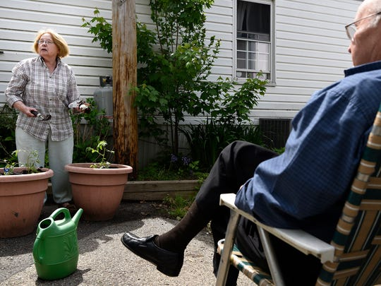 Carol Roeland plants tomatoes as her husband, Peter, looks on at Metropolitan Mobile Homes Park near Teterboro Airport on Tuesday.