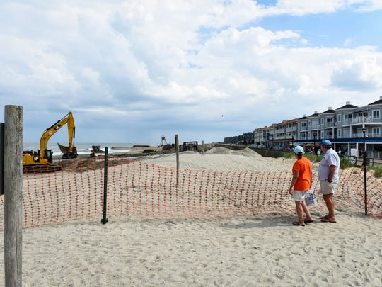 Beach-goers looked on as a large section of Bethany Beach underwent annual beach replenishment on Thursday.