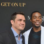 "Director Tate Taylor, left, and Chad Boseman, star of the James Brown biopic ""Get On Up,"" pose during a recent screening in Madison."