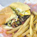 The Fairfield Market hamburger, served with chips and a dill pickle, is on the Times list as a possible best burger.
