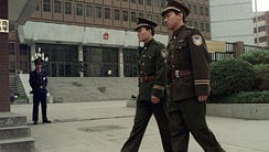 Chinese police officers patrol in front of Shanghai