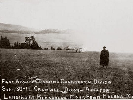 A bystander watches as 19-year-old Cromwell Dixon lands