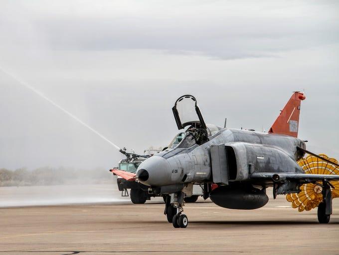 An F-4 Phantom II makes its way down the runway after