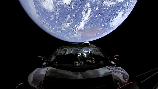 This image from video provided by SpaceX shows the company's spacesuit in Elon Musk's red Tesla sports car which was launched into space.