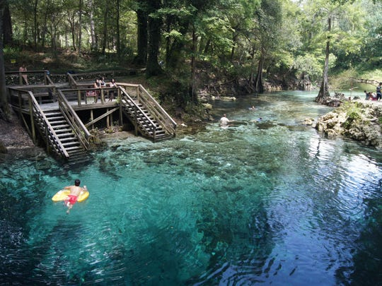 """East of Tallahassee, Madison Blue Springs State Park possesses a magical """"other worldly"""" feel as a first-magnitude crystal clear spring spilling into the Withlacoochee River."""