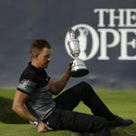 Henrik Stenson of Sweden holds onto the trophy as he poses for the media after winning the British Open Golf Championships at the Royal Troon Golf Club in Troon