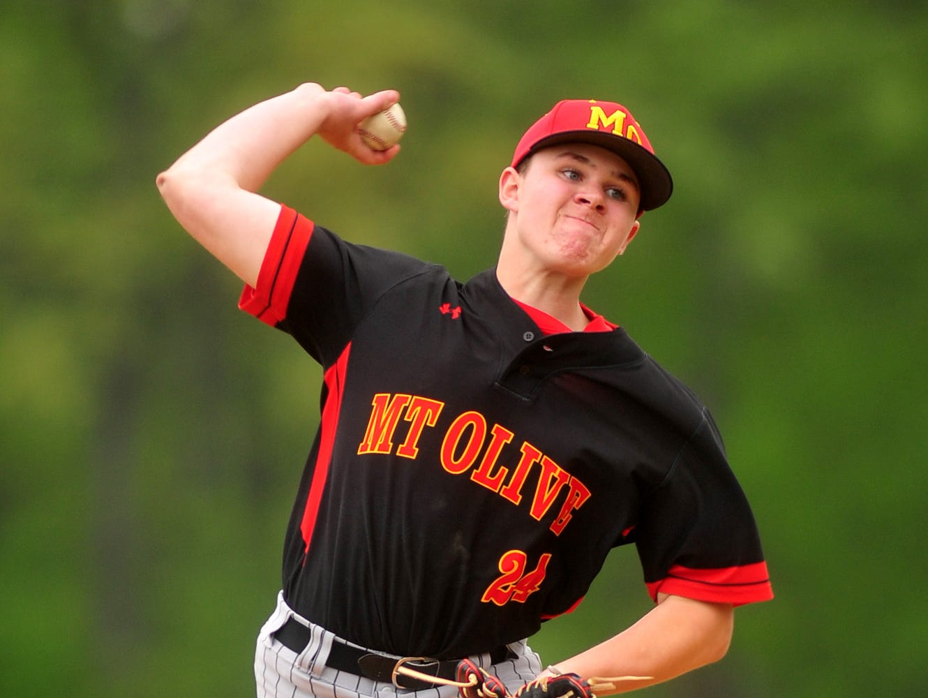 Pitcher Greg Helmlinger allowed three runs, walked one and struck out eight as No. 14 Mount Olive upset No. 3 Montville in the Morris County Tournament on Saturday.