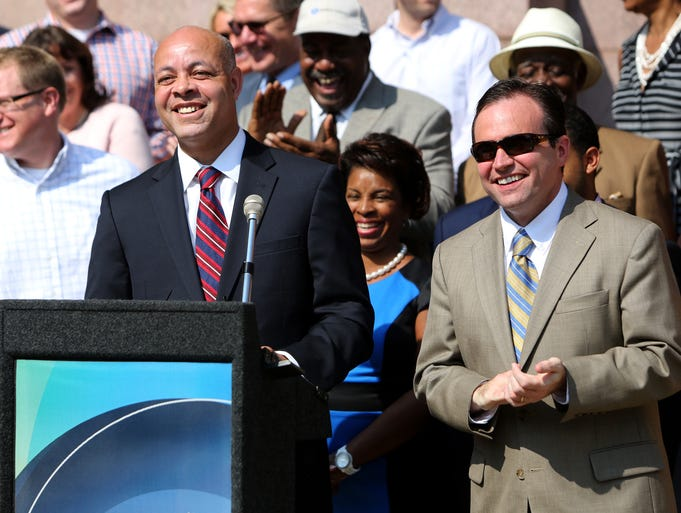 Harry Black, Baltimore's finance director, and Cincinnati mayor, John Cranley, laugh during a press conference announcing Black as Cranley's pick to become the new city manager of Cincinnati in front of City Hall Thursday.
