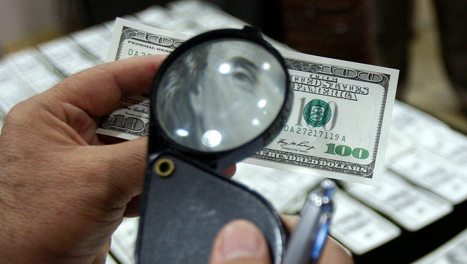 This is a file photo showing an alleged counterfeit $100 U.S. dollar bill.