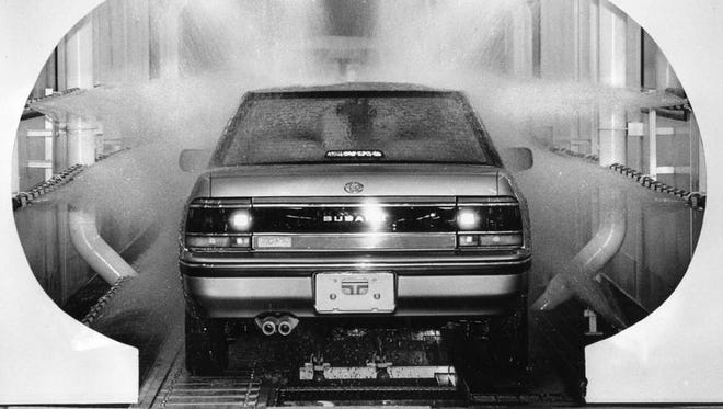 A car is washed after finishing touches at Subaru-Isuzu, Oct. 16, 1989.