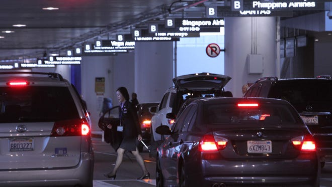 Cars line up to pick up arriving international air travelers at Tom Bradley International Terminal at Los Angeles International Airport (LAX) earlier this year.
