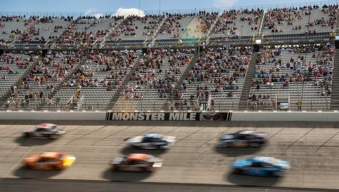 Cars run through turns three and four in front of a sparse crowd in the AAA 400  at Dover International Speedway on Sunday afternoon, September 29, 2013.