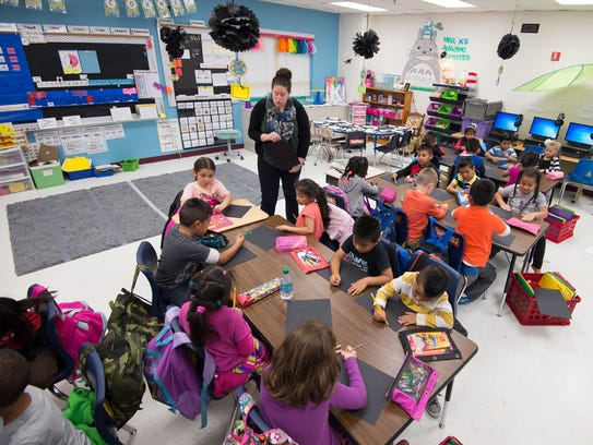First-grade teacher Hannah Korschgen works with her students at North Georgetown Elementary School in this 2017 file photo.