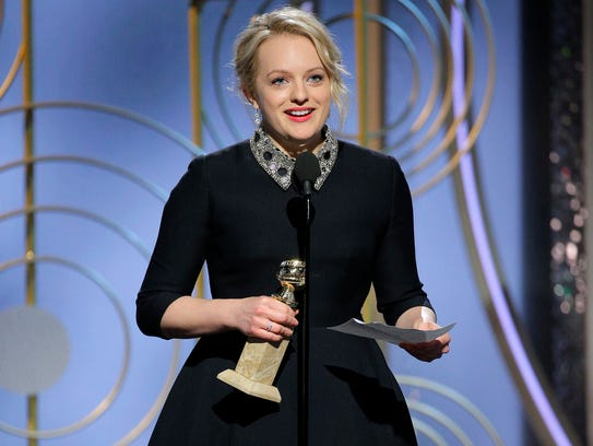 """After winning best actress in a TV drama series, Elisabeth Moss urged greater involvement for women on both sides of the camera:""""We want to tell stories that reflect our lives back at us."""""""
