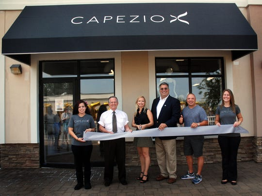 Union County Freeholder Alexander Mirabella joined Clark Councilman Al Barr, Capezio Vice President of Global Retail Michelle Clemack, store manager Kim Maskal, management team member Amanda Guerra and Z-100's Greg T in cutting the ribbon officially opening the new Capezio store on Central Avenue in Clark.