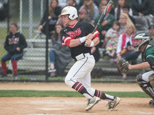 Bennett's Grayson Winterbottom (12) hits the ball during a game against Parkside on Wednesday, April 19, 2017.