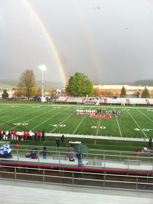 The Susquehannock and West York girls' soccer teams get ready for their game Wednesday night at Susquehannock as a rainbow forms nearby.  (Daily Record/Sunday News -- John Clayton)