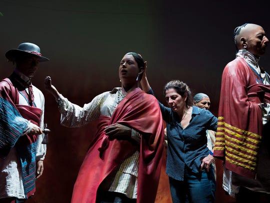 Karen Atta, founder of Atta Studio, adjusts her figures