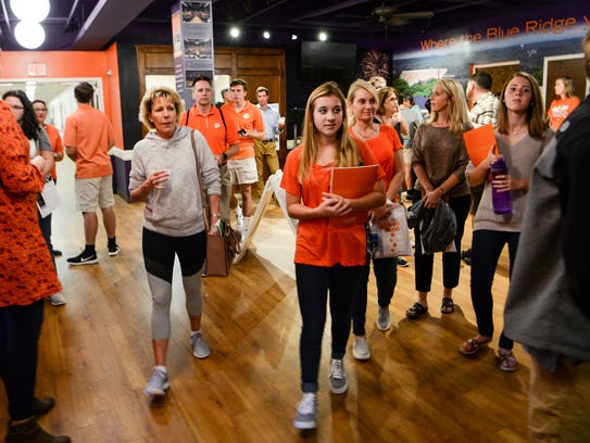 Susie Edwards, left, of Charleston, a 1989 business accounting graduate from Clemson, walks with incoming freshman Jenna Bolding, middle, of Greenville and her mother, Diana Bolding, right, a 1991 Clemson University marketing graduate, during a tour of the College of Business at Sirrine Hall on Oct. 20, 2017.