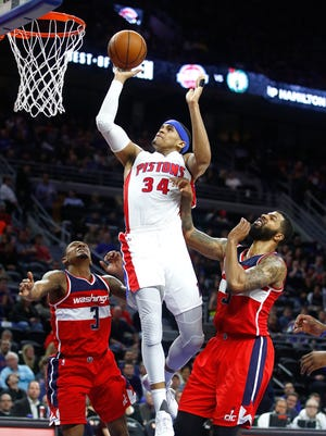 Pistons forward Tobias Harris splits the defense of Wizards guard Bradley Beal, left, and forward Markieff Morris during the second half of the Pistons' 113-112 win Jan. 21, 2017 at the Palace.
