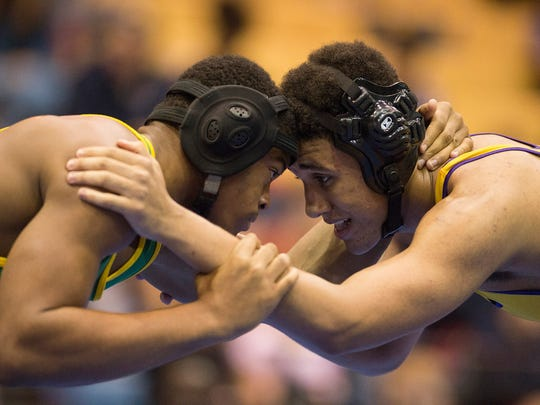 Jupiter's Jaq Jones (left) wrestles Fort Pierce Central's Josh Westberry during their 170 pound match during the high school 3-A district 9 wrestling tournament at Martin County High School on Saturday, Feb. 18, 2017, in Stuart. Westberry won the match. To see more photos, go to TCPalm.com.