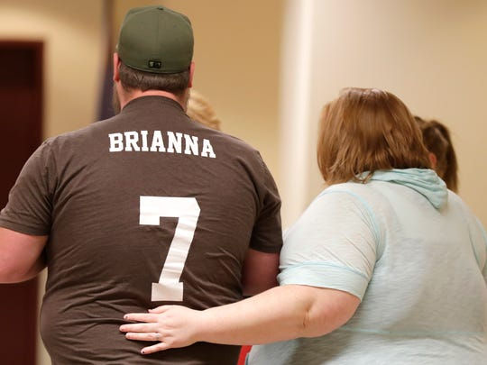 Greg Gussert, the father of Brianna Gussert, wears a shirt with his daughter's name across the back after his ex-wife Nicole L. Gussert, 37, of Appleton, was charged with one count of child neglect resulting in death and three counts of possession with intent to deliver amphetamine. She was ordered held on a $300,000 cash bond on Monday at the Outagamie County Justice Center in Appleton. Gussert is accused of neglecting her daughter who had disabilities, causing the 13 year old girl's death.