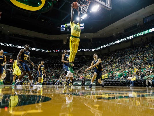 Oregon forward Chris Boucher (25), dunks on California in an NCAA college basketball game Thursday, Jan. 19, 2017, in Eugene, Ore. (AP Photo/Thomas Boyd)
