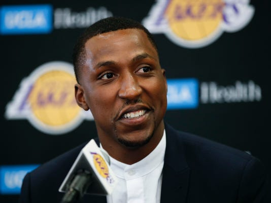 Los Angeles Lakers' Kentavious Caldwell-Pope speaks during a news conference Tuesday, July 18, 2017, in Los Angeles. (AP Photo/Jae C. Hong)