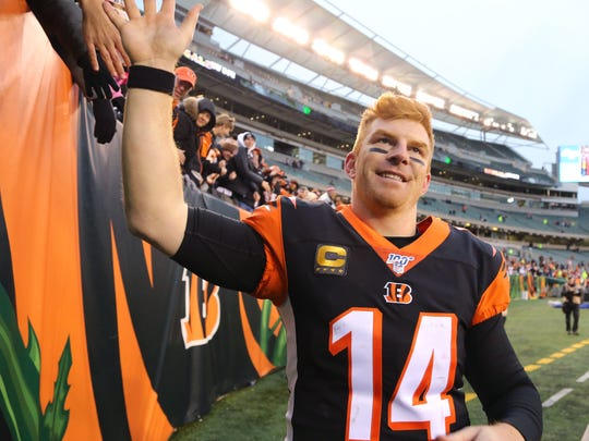 Dec. 1, 2019: Cincinnati Bengals quarterback Andy Dalton (14) celebrates as the team gets the first win of the season against the New York Jets at Paul Brown Stadium.