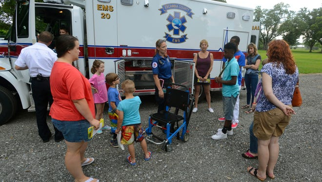Emergency Medical Technician Tasha Boros talks about the equipment the ambulance carries Saturday during the EMS Open House at the Escambia County Public Safety complex on north W. St.