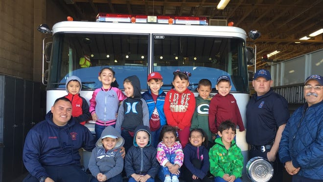 Fruit of the Vine Preschool visited the Deming Fire Department last week at 301 S. Gold St. The students were given a tour of the station and were excited to see the fire trucks up close. Pictured, along with firefighters, are, top row, from left: Neiam Borja, Mia Enriquez, Vincent Arnett, Joseph Turner, Aileya Camuñez, Nathaniel Gamboa and Jayden Carillo. At bottom, from left, are: Alexander Villareal, Jacobo Baca, Danika Serna, Jazlene Rodriguez and Gabriel Maynes. Fruit of the Vine teachers thank the firefighters and first responders EMTs for the visit.