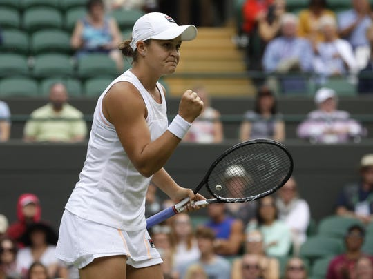 Australia's Ashleigh Barty celebrates after beating China's Saisai Zheng in their Women's singles match during Day 2 of the Wimbledon Tennis Championships in London.