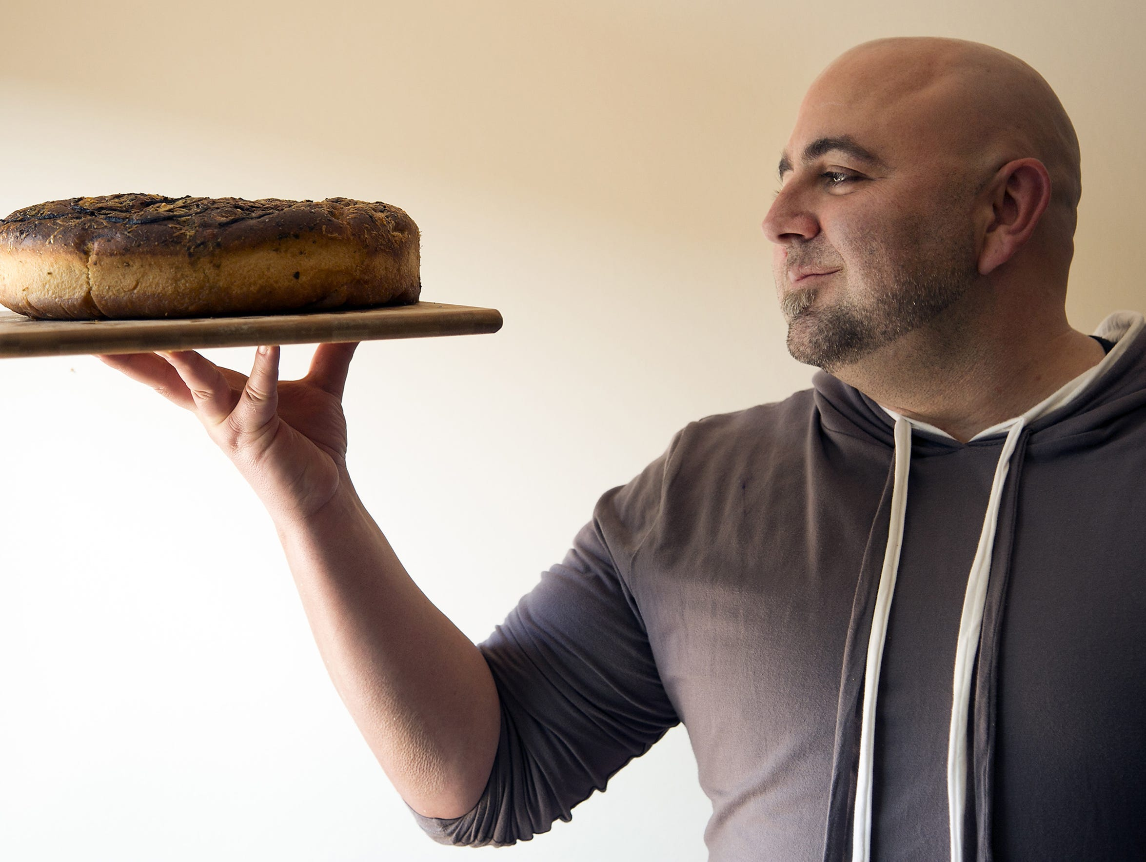 Duff Goldman holds his focaccia. Photos by Myung J.