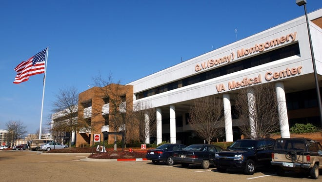 In this 2004 file photo, the nation's flag flies high at the G.V. (Sonny) Montgomery VA Medical Center, in Jackson, Miss.