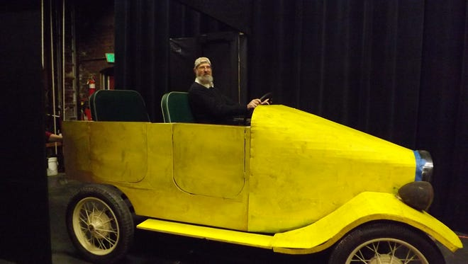 """The Great Gatsby"" director, TJ Rivard, drives the car on stage before a rehearsal."