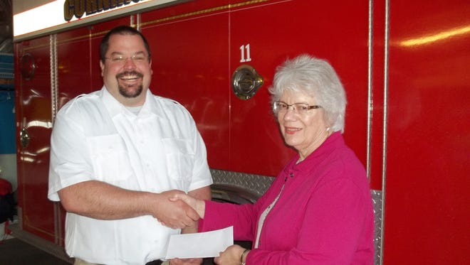 As pictured, Chief Dave Hoff accepts grant money from Janet Kleinschmidt, Mutual of Wausau agent.