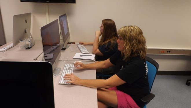 Andrea Dickey, foreground, and Katie Stonebraker, both of Richmond, are students in a computer graphics technology class at Purdue Polytechnic Richmond.