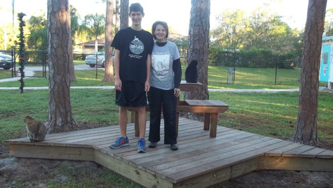 Steven Vokoun and Pauline Glover look over the deck built by Scouts.