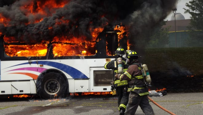 A bus burns in Paramus outside Bergen Community College June 20, 2018.