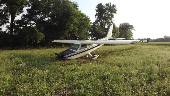 A plane on the way to the EAA event in Oshkosh was forced to make an emergency landing in a farm field in Waupaca County.