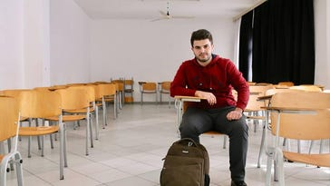 """Alaa Alsaabee wants to return to his master's studies at Wayne State, but afterward plans to return to his home and family. """"There's massive destruction in Syria. I want to build my country again,"""" he said."""