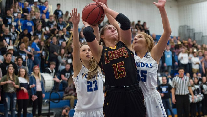 Gabriella McDonald of Rocky Mountain High School gets around McKenzee Gertz and Delaney McKee of Poudre during a game Friday, January 27, 2017. The Lobos defeated the Impalas 51-48 in double overtime.